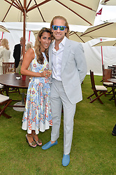 JAKE PARKINSON-SMITH and his wife SAMIKA PARKINSON-SMITH at the Cartier Queen's Cup Final polo held at Guards Polo Club, Smith's Lawn, Windsor Great Park, Egham, Surrey on 15th June 2014.