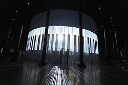 © licensed to London News Pictures. LONDON, UK.  08/08/11. People interact with Pianorama, by Christian Marclay. Ron Arad's Curtain Call opens at the Roundhouse, Camden in London today (9th August 2011). Arad has installed a huge light curtain made of 5,600 silicon rods, suspended from an 18 metre diameter ring. Films, live performance and audience interaction can all take place within and around the rods. Mandatory Credit Stephen Simpson/LNP