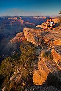 Kids on rock at Sunset at Yavapai Point, South Rim, Grand Canyon National Park, Arizona