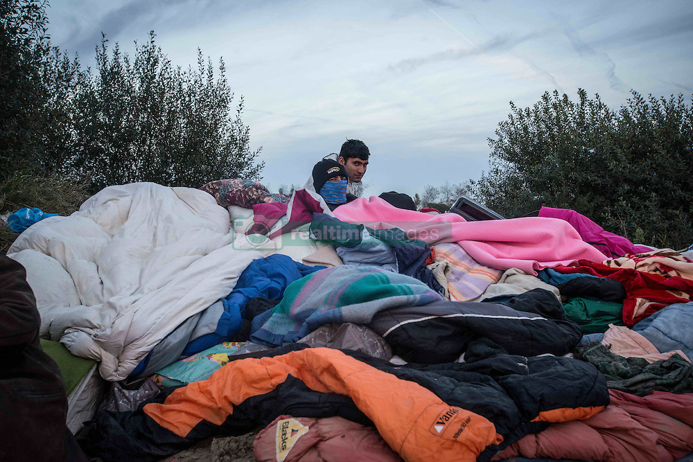 October 27, 2016 - Calais, France - young migrants, among them minors, waiting outside of the white container camp. Calais 27/10/2016  (Credit Image: © Guillaume Pinon/NurPhoto via ZUMA Press)