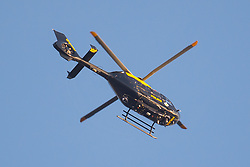 A Police helicopter flies over London Bridge and Borough Market in London following last night's terrorists incidents.