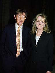 The HON.ADAM & MRS MACMILLAN, he is the brother of the Earl of Stockton, at a party in London on 25th November 1997.MDR 57