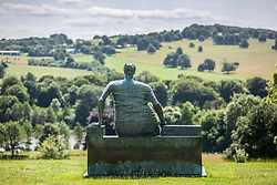 © Licensed to London News Pictures. 26/09/2017. Wakefield UK. File picture taken 09/07/2015 show the old flo sculpture at Yorkshire Sculpture Park. Henry Moore's sculpture Draped Seated Woman 1957, affectionately known as 'Old Flo' is being removed from the Yorkshire Sculpture park today after 20 years on public display at the park. The iconic sculpture was loaned to YSP by the London Borough of Tower Hamlets in 1997, after the Stifford Estate in Stepney where it had been located since 1962 was demolished. The sculpture will be returning to Tower Hamlets to be sited in a new home in Cabot Square, Canary Wharf. The return of the sculpture to London marks an end to a bitter political battle over Old Flo. In 2012 the disgraced former mayor of Tower Hamlets Lutfur Rahman, declared that it should be sold to raise £20m, that sparked protests & a court battle over who actually owned the sculpture. Tower Hamlets was confirmed as the legal owner in 2015. Photo credit: Andrew McCaren/LNP