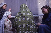 Kabul. Young Hazara girls weave a carpet