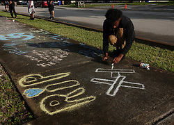 Lenar Nesmith of Pompano Beach, a fan of Broward-based rapper XXXTentacion, whose given name was Jahseh Onfroy, visits the shooting scene on Tuesday, June 19, 2018, outside Riva Motorsports in Pompano Beach where Onfroy was gunned down and killed Monday. Photo by Joe Cavaretta/Sun Sentinel/TNS/ABACAPRESS.COM