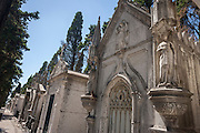 Tombs and mausoleums in Prazeres Cemetery (Cemitério dos Prazeres), the largest cemetery in Lisbon, Portugal. Many famous Portuguese citizens are buried here, including artists, authors and government figures, and the cemetery features many large structures built in the 19th century