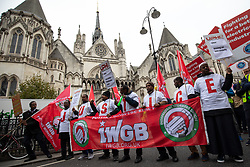 © Licensed to London News Pictures. 30/10/2018. London, UK. The Independent Workers Union of Great Britain hold an employments rights demonstration titled 'Rise of the Precarious Workers'. The demonstration starts at Transport for London, passing the Royal Courts of Justice - where the IWGB is currently fighting  a case against Uber - and ends at the University of London. Photo credit : Tom Nicholson/LNP