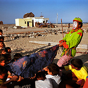 A clown performs an act about the tsunami to help children get over their trauma in a village near Chennai, on the southeastern coast of India..The December 26, 2004 tsunami killed thousands of people along this coast, smashing boats, roads and houses and tearing thousands of families apart. .Picture taken February 2005 in Nagapptinam, Tamil Nadu, India, by Justin Jin
