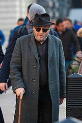 London February 15th 2015. British Pakistanis demonstrate outside Downing Street against Altaf Hussain a Pakistani politician living in exile as a naturalised citizen in the United Kingdom. The Muttahida Qaumi Movement (MQM) leader  is accused of masterminding dozens of politically motivated murders in Pakistan.PICTURED:  George Galloway MP arrives using a stick to support himself, still suffering the effects of anassault several months earlier.  //Contact/payment details tel 07966016296 paul@pauldaveycreative.co.uk
