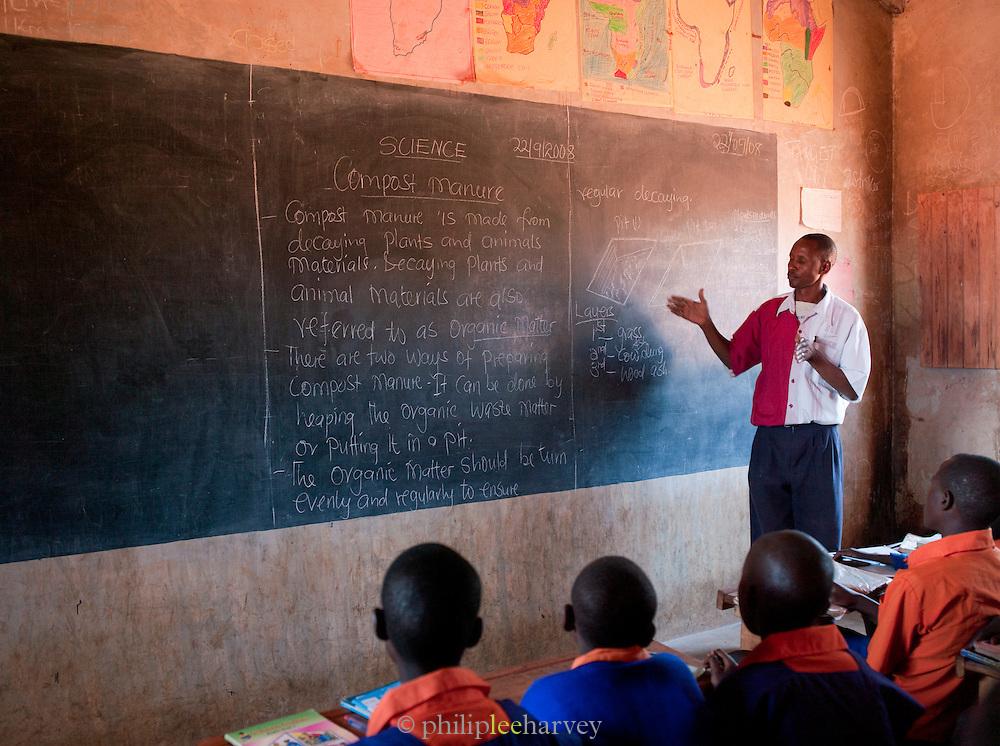School teacher with his class in Iloileri School near Amboseli National Park, Rift Valley Province, Kenya