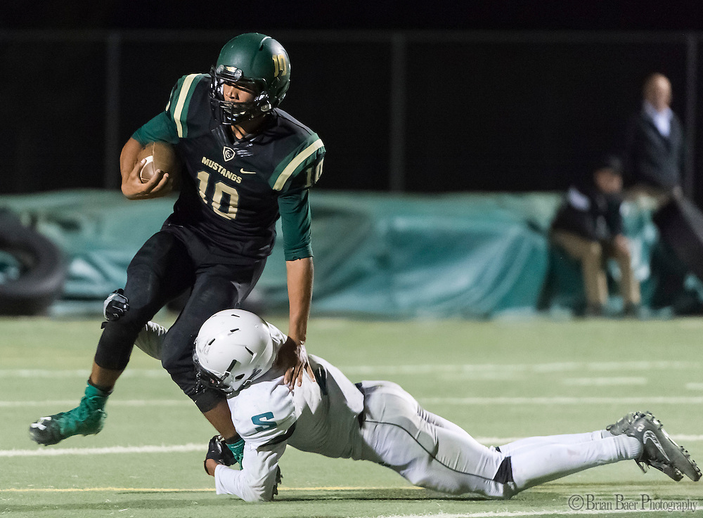Sheldon High School Husky Alex Cook (2), tackles Monterey Trail Mustangs Robert Holt (10), as he runs with the ball during the fourth quarter as the Monterey Trail Mustangs host the Sheldon High School Huskies Friday Sep 23, 2016. Sheldon won the game 27-22.<br /> photo by Brian Baer