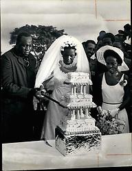 Aug. 08, 1975 - Idi Amin using the fild-marshallis Sword, the happy cut the cake - his new wife - Sarah Kyolaba. (Credit Image: © Keystone Press Agency/Keystone USA via ZUMAPRESS.com)