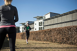 Woman observing man jogging outdoors