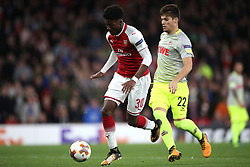 Arsenal's Ainsley Maitland-Niles (left) and FC Koln's Jorge Mere during the Europa League match at the Emirates Stadium, London.
