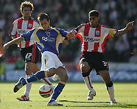 Photo: Lee Earle.<br /> Southampton v Cardiff City. Coca Cola Championship. 21/10/2007. Cardiff's Roger Johnson (L) tries a shot at goal as Southampton's Youssef Safri (R) approaches.
