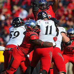Defensive tackle Jamil Merrell #92 of Rutgers sacks the quarterback while Djwany Mera #93 of Rutgers knocks down a pass at the line of scrimmage during American Athletic Conference Football action between Rutgers and Cincinnati on Nov. 16, 2013 at High Point Solutions Stadium in Piscataway, New Jersey.