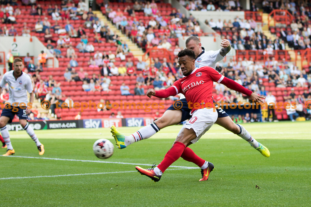 Charlton Striker Nicky Ajose beats his marker during the Sky Bet League 1 match between Charlton Athletic and Bolton Wanderers at The Valley in London. August 27, 2016.<br /> Sam Falaise / Telephoto Images<br /> +44 7967 642437