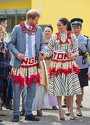 The Duke and Duchess of Sussex wear ta'ovala during a visit to an exhibition of Tongan handicrafts at the Fa'onelua Convention Centre, in Nuku'Alofa, Tonga, on day two of the royal couple's visit to Tonga.