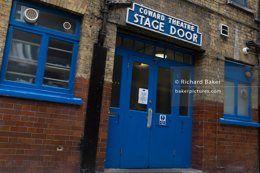 With a further 89 UK covid victims in the last 24hrs, bringing the total victims to 43,995 during the Coronavirus pandemic, pubs, restaurants, hairdressers and some art galleries can re-open on Saturday 4th July -though not theatres or indoor entertainment venues. The blue stage door remains locked at the rear of the Noel Coward Theatre, on 2nd July 2020, in London, England.