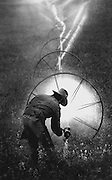 Near Othello, a farmer irrigates a field with water that has traveled hundreds of miles from the Columbia River. (Tom Reese / The Seattle Times, 1991)