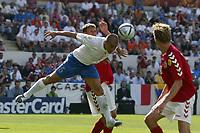 Guimaraes 14/6/2004 <br />Campionati Europei - European Championships 2004 <br />Danimarca Italia <br />intervento difensivo di fabio cannavaro<br /><br />Photo Graffiti
