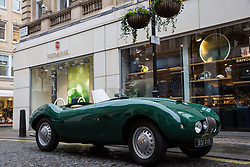 London, UK. 29th November, 2018. Auctioneers Bonhams move a 1954 Arnolt-Bristol Bolide Roadster in preparation for an auction of historic and high-performance racing and road cars. Highlights include a Le Mans class-winning Jaguar XJ220C driven by David Coulthard (£2,200,000-2,800,000), a Lister Jaguar Knobbly (£2,200,000-2,800,000) and a 1958 BMW 507 owned by its designer, as well as Ferraris, Aston Martins, Bentleys, Porsches and Jaguars. Bonhams, founded in 1793, is one of the world's largest and most renowned auctioneers of fine art and antiques, motor cars and jewellery.