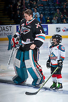 KELOWNA, CANADA - DECEMBER 5: Jackson Whistle #1 of Kelowna Rockets lines up with the Pepsi Save On Foods Player of the Game against the Portland Winterhawks on December 5, 2015 at Prospera Place in Kelowna, British Columbia, Canada.  (Photo by Marissa Baecker/Shoot the Breeze)  *** Local Caption *** Jackson Whistle; Pepsi Player;