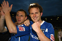 Stuart Lewis clenches his fist as Gillingham captian Barry Fuller applauds there supporters<br /> Gillingham vs Rochdale at the Priestfield Stadium Gillingham<br /> League Two Play Off Semi Final Second Leg 10/05/2009<br /> Credit Colorsport / Shaun Boggust