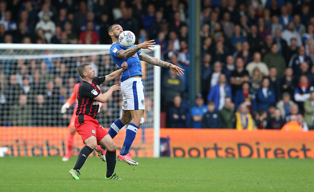 Oldham Athletic's Craig Davies and Blackburn Rovers' Paul Caddis<br /> <br /> Photographer Stephen White/CameraSport<br /> <br /> The EFL Sky Bet League One - Oldham Athletic v Blackburn Rovers - Saturday 14th October 2017 - Boundary Park - Oldham<br /> <br /> World Copyright © 2017 CameraSport. All rights reserved. 43 Linden Ave. Countesthorpe. Leicester. England. LE8 5PG - Tel: +44 (0) 116 277 4147 - admin@camerasport.com - www.camerasport.com