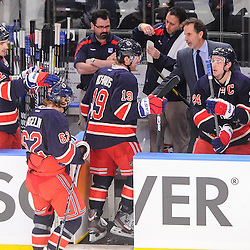 New York Rangers head coach John Tortorella congratulates New York Rangers right wing Ryan Callahan (24) and his line mates on his goal during first period NHL action between the Washington Capitals and the New York Rangers at Madison Square Garden in New York, N.Y.