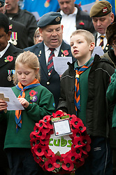 Local Cubs wait to lay a wreath at the War memorial in Chapeltown Park in Sheffield South Yorkshire up during the local Remembrance Day service 2011.13 November 2011. Image © Paul David Drabble