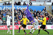 Watford goalkeeper Heurelho Gomes saves to keep Swansea out. Premier league match, Swansea city v Watford at the Liberty Stadium in Swansea, South Wales on Saturday 22nd October 2016.<br /> pic by  Carl Robertson, Andrew Orchard sports photography.