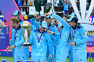 Eoin Morgan of England has champaign tipped over his head by Jos Buttler of England during the trophy presentation celebrations during the ICC Cricket World Cup 2019 Final match between New Zealand and England at Lord's Cricket Ground, St John's Wood, United Kingdom on 14 July 2019.
