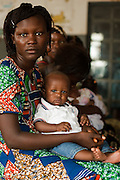A mother and her child in a waiting room at the Pujehun Government hospital in Pujehun, Sierra Leone on Friday March 19, 2010..