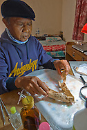 Rokhus Due Awe works long evenings in his guest-house-turned-bone-lab near Liang Bua Cave. Here he reconstructs the jaw of a baby pygmy Stegodon, an extinct relative of elephants. It appears that Homo floresiensis brought baby Stegodons into Liang Bua for buthcering and cooking. No adults have been found.