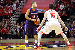 15 January 2016: D.J. Balentine(31) looks past defender Justin McCloud(15) during the Illinois State Redbirds v Evansville Purple Aces at Redbird Arena in Normal Illinois (Photo by Alan Look)