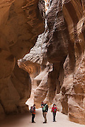 Members of the Leshem family, from Israel, stand in Al Siq, the slot canyon entrance to Petra, Jordan.