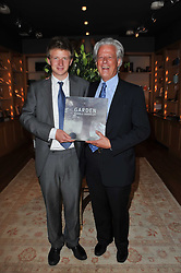 Left to right, the HON.EDWARD SIDDELEY and his father RANDLE SIDDELEY (LORD KENILWORTH) at a party to celebrate the publication of 'Garden' by Randle Siddeley held at Linley, 60 Pimlico Road, London on 24th May 2011.