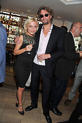 SIMONE NICA and NICK REYNOLDS at a party to celebrate the publication on The House of Rumour by Jake Arnott held at The Ivy Club, West Street, London on 9th July 2012.