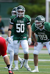 19 September 2015:   Tyler Fahey and Don Nordstrom during an NCAA division 3 football game between the Simpson College Storm and the Illinois Wesleyan Titans in Tucci Stadium on Wilder Field, Bloomington IL