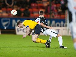 Falkirk's Darren Dods tackled by Dunfermline's Andy Barrowman..Dunfermline 0 v 1 Falkirk, 26/12/2012..©Michael Schofield.