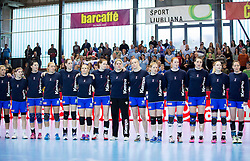 Players of Slovenia listening to the national anthem during handball game between Women National Teams of Slovenia and Switzerland in 2014 Women's European Championship Qualification, on March 30, 2014 in Arena Kodeljevo, Ljubljana, Slovenia. Photo by Vid Ponikvar / Sportida