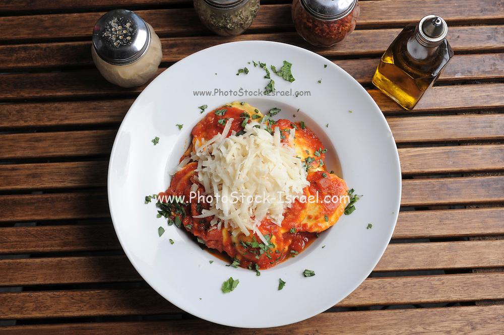 plate of Ravioli with marinara sauce and cheese