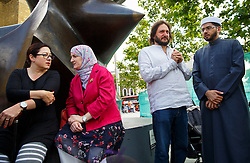© Licensed to London News Pictures. 06/07/2015. London, UK. 7/7 survivor Gill Hicks talking to Julie Siddiqi outside King's Cross station on Monday, July 6, 2015 before walking to Tavistock Square with faith leaders to commemorate the 10th anniversary of 7/7 bombings by remembering those who lost their lives, as well as offering a message of peace and unity between people of different faiths and backgrounds. Photo credit: Tolga Akmen/LNP
