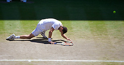 04.07.2014, All England Lawn Tennis Club, London, ENG, ATP Tour, Wimbledon, im Bild Grigor Dimitrov (BUL) slips over during the Gentlemen's Singles Semi-Final match on day eleven // during the Wimbledon Championships at the All England Lawn Tennis Club in London, Great Britain on 2014/07/04. EXPA Pictures © 2014, PhotoCredit: EXPA/ Propagandaphoto/ David Rawcliffe<br /> <br /> *****ATTENTION - OUT of ENG, GBR*****