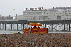 © Licensed to London News Pictures. 26/08/2014. Brighton, UK. An empty beach after heavy rain hit Brighton during lunch time on Tuesday August 26th 2014. Temperatures are expected to reach around the 14C in Brighton and the South Coast. Photo credit : Hugo Michiels/LNP