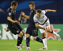 21.08.2013, Maksimir Stadion, Zagreb, CRO, UEFA CL Qualifikation, GNK Dinamo Zagreb vs FK Austria Wien, Hinspiel, im Bild Arijan Ademi, Said Husejinovic, James Holland // during the UEFA Champions League, Qualification first leg match between GNK Dinamo Zagreb and FK Austria Wien at Maksimir Stadium in Zagreb, Croatia on 2013/08/21. EXPA Pictures © 2013, PhotoCredit: EXPA/ Pixsell/ Igor Kralj<br /> <br /> ***** ATTENTION - for AUT, SLO, SUI, ITA, FRA only *****