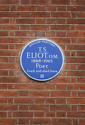 Blue plaque to T. S. Eliot, poet, 1888 - 1965. 3 Kensington Court Gardens. He lived and dies at this address. London's blue plaques scheme, founded in 1866, is believed to be the oldest of its kind in the world and has inspired many other schemes across London, the UK and even further afield. Run successively by the (Royal) Society of Arts, the London County Council, the Greater London Council, and since 1986, English Heritage, it commemorates the link between notable figures of the past and the buildings in which they lived and worked. It is a uniquely successful means of connecting people and place. London, UK.