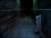 Towel on a hanger in a dark basement