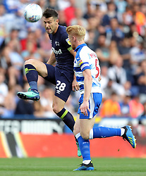 Derby County's David Nugent (left) and Reading's Paul McShane battle for the ball during the Sky Bet Championship match at the Madejski Stadium, Reading.